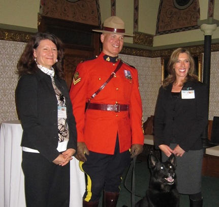 CFHS CEO Barbara Cartwright, RCMP officers and Central Alberta Humane Society CEO Tara Hellewell after Quanto's Law was passed
